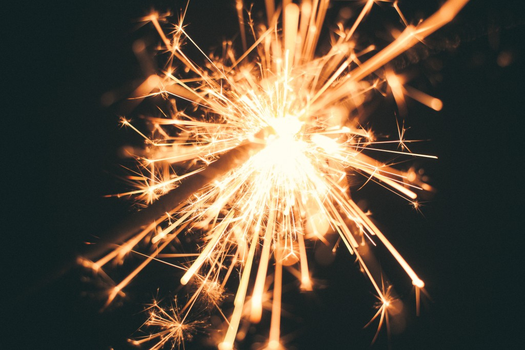 a sparkler lights up the night
